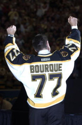 4 Oct 2001:  Ray Bourque #77 of the Boston Bruins during a ceremony in which the Bruins retired his number 77 before their home opener against the Anaheim Mighty Ducks at the Fleet Center in Boston, Massachusetts. <DIGITAL IMAGE>    Mandatory Credit: Ezra