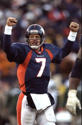 17 Jan 1999:  John Elway #7 of the Denver Broncos celebrates during the AFC Championship Game against the  New York Jets at Mile High Stadium in Denver, Colorado. The Broncos defeated the Jets 23-10. Mandatory Credit: Brian Bahr  /Allsport
