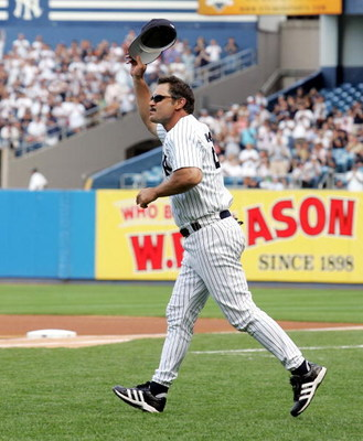 NEW YORK - JULY 9: Don Mattingly salutes the crowd after being introduced during New York Yankees 59th annual old timers day before the start of the Yankees game against the Cleveland Indians on July 9, 2005 at Yankee Stadium in the Bronx borough of New Y