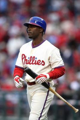 PHILADELPHIA - APRIL 08:  Jimmy Rollins #11 of the Philadelphia Phillies on deck to bat against the Atlanta Braves at Citizens Bank Park on April 8, 2009 in Philadelphia, Pennsylvania.  (Photo by Nick Laham/Getty Images)