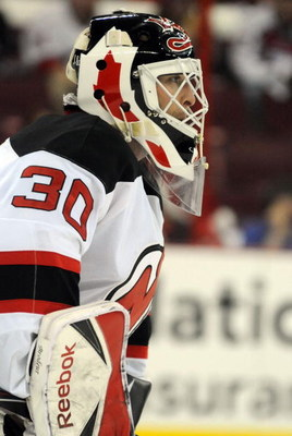 RALEIGH, NC - APRIL 26: Martin Brodeur #30 of the the New Jersey Devils keeps a close eye on the action in the first period of Game Six of the Eastern Conference Quarterfinals of the 2009 Stanley Cup Playoffs against the Carolina Hurricanes i on April 26,