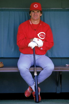 1986:  Pete Rose of the Cincinnati Reds sits in the dug-out during a MLB game in the 1986 season. ( Photo by: Stephen Dunn/Getty Images)