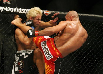 CHICAGO- OCTOBER 25:  Josh Koscheck (L) fights Thiago Alves in a Welterweight bout  at UFC's Ultimate Fight Night at Allstate Arena on October 25, 2008 in Chicago, Illinois. (Photo by Tasos Katopodis/Getty Images)