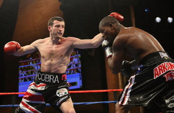 MASHANTUCKET, CT - APRIL 25:  Carl Froch lands a left on Jermain Taylor during their WBC Super Middleweight Championship bout at the MGM Grand at Foxwoods on April 25, 2009 in Mashantucket, Connecticut.  (Photo by Nick Laham/Getty Images)