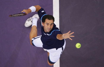 MADRID, SPAIN - OCTOBER 20:  Albert Costa of Spain serves during his second round match against Tim Henman of Great Britain during the ATP Madrid Masters at the Nuevo Rockodromo on October 20, 2004 in Madrid, Spain. (Photo by Jamie McDonald/Getty Images)