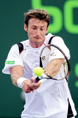 KEY BISCAYNE, FL - MARCH 30:  Juan Carlos Ferrero of  Spain returns a shot against Tomas Berdych of the Czech Republic during day seven of the Sony Ericsson Open at the Crandon Park Tennis Center on March 30, 2008 in Key Biscayne, Florida.  (Photo by Al B