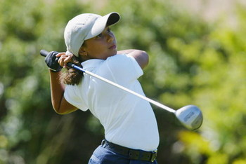 SAN DIEGO - July 17:  Cheyenne Woods, niece of Tiger Woods, tees off the 10th hole during the 2nd Round of the Junior World Golf Championships on July 17, 2002 at the Lawrence Welk Resort in San Diego, California.  (Photo by Dolanld Miralle/Getty Images)