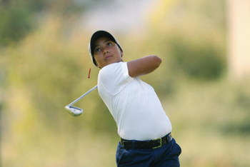 SAN DIEGO - July 17:  Cheyenne Woods, niece of Tiger Woods, tees off the 8th hole during the 2nd Round of the Junior World Golf Championships on July 17, 2002 at the Lawrence Welk Resort in San Diego, California.  (Photo by Dolanld Miralle/Getty Images)