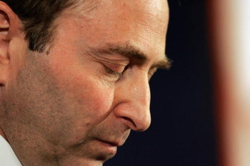 NEW YORK - FEBRUARY 16:  National Hockey League Commissioner Gary Bettman looks down as he announces that the 2004-05 season is being canceled during a news conference at the Westin New York, Times Square, February 16, 2005 in New York City. The NHL becom