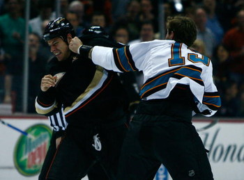 ANAHEIM, CA - APRIL 27:  (R-L) Center Joe Thornton #19 of the San Jose Sharks fights with center Ryan Getzlaf #15 of the Anaheim Ducks at the beginning of Game Six of the Western Conference Quarterfinal Round of the 2009 Stanley Cup Playoffs at the Honda