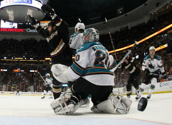 ANAHEIM, CA - APRIL 27:  Mike Brown #13 of the Anaheim Ducks celebrates a goal by Francois Beauchemin #23 as Evgeni Nabokov #20 of the San Jose Sharks looks on during Game Six of the Western Conference Quarterfinal Round of the 2009 Stanley Cup Playoffs a