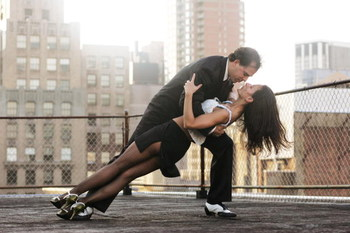 NEW YORK - JUNE 17:  Javier Garcia and Moira Sauvane dance the tango on a Manhattan rooftop June 17, 2005 in New York City. Javier Garcia, an Argentinian-American and a third-year psychiatric resident, and Moira Sauvane, an Argentinian and a post doctoral