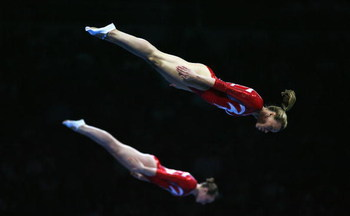 BEIJING - AUGUST 20: The Canadian team perform the synchronised trampoline in the Gymnastics Gala at the National Indoor Stadium during Day 12 of the Beijing 2008 Olympic Games on August 20, 2008 in Beijing, China.  (Photo by Clive Brunskill/Getty Images)