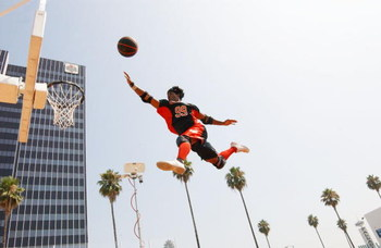 LOS ANGELES - JULY 30:  Athlete LaMonica Garrett demonstrates the new team action sport 'Slamball' at a live exhibition at Nick on Sunset on July 30, 2002 in Los Angeles, California.  The new sport debuts Saturday August 3, 2002 on TNN.  (Photo by Robert