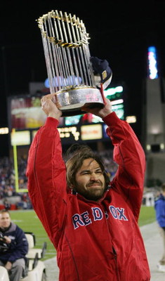 FOXBORO, MA - NOVEMBER 14:  Boston Red Sox player Johnny Damon show off the World Series trophy before the New England Patriots game against the Buffalo Bills at Gillette Stadium on November 14, 2004 in Foxboro, Massachusetts. (Photo by Ezra Shaw/Getty Im