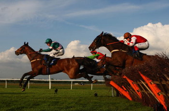 HUNTINGDON, ENGLAND - APRIL 30:  Island Arrow ridden by Andrew Tinkler jumps a hurdle to win the Champions League Free Bets Handicap Hurdles race at Huntingdon on April 30, 2009 in Huntingdon, England.  (Photo by Jamie McDonald/Getty Images)
