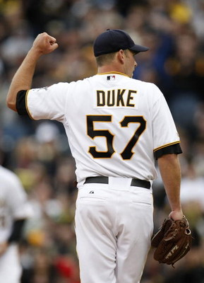 PITTSBURGH - APRIL 13:  Zach Duke #57 of the Pittsburgh Pirates reacts to the final out after throwing a complete game and beating the Houston Astros 7-0 during the Pirates Home Opener at PNC Park April 13, 2009 in Pittsburgh, Pennsylvania.  (Photo by Gre
