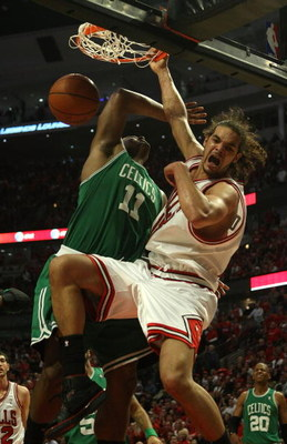 CHICAGO - APRIL 26: Joakim Noah #13 of the Chicago Bulls dunks the ball over Glen Davis #11 of the Boston Celtics in Game Four of the Eastern Conference Quarterfinals during the 2009 NBA Playoffs at the United Center on April 26, 2009 in Chicago, Illinois