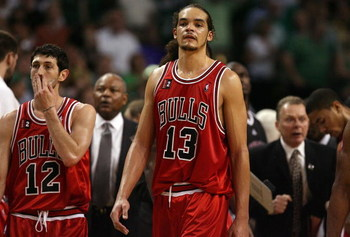 BOSTON - APRIL 28:  Kirk Hinrich #12 and Joakim Noah #13 of the Chicago Bulls look on during a time out against the Boston Celtics in Game Five of the Eastern Conference Quarterfinals during the 2009 NBA Playoffs at TD Banknorth Garden on April 28, 2009 i
