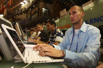 VALENCIA, SPAIN - MARCH 07:  Jeremy Wariner, CEO of AF, takes part in an internet blog during the 12th IAAF World Indoor Championships at the Palau Lluis Puig on March 7, 2008 in Valencia, Spain.  (Photo by Stu Forster/Getty Images)