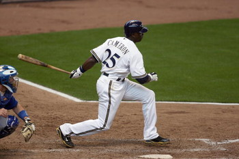 MILWAUKEE - APRIL 10: Mike Cameron #25 of the Milwaukee Brewers makes a hit against the Chicago Cubs during the Opening Day game on April 10, 2009 at Miller Park in Milwaukee, Wisconsin. The Brewers defeated the Cubs 4-3. (Photo by Jonathan Daniel/Getty I
