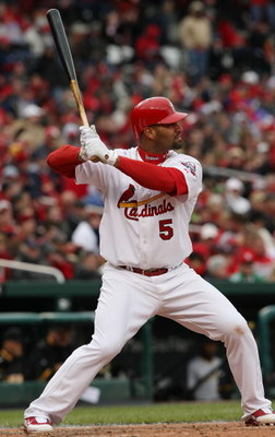 ST. LOUIS - APRIL 06:  :  :  Albert Pujols #5 of the St. Louis Cardinals takes a swing against the Pittsburgh Pirates during Opening Day on April 6, 2009  at Busch Stadium in St. Louis, Missouri. The Pittsburgh Pirates defeated the St. Louis Cardinals 6-4