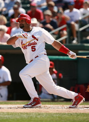 JUPITER, FL - MARCH 02:  Albert Pujols #5 of the St. Louis Cardinals follows through on a single against the Florida Marlins during a Spring Training game at Roger Dean Stadium on March 2, 2008 in Jupiter, Florida.  (Photo by Doug Benc/Getty Images)