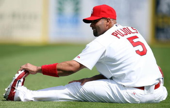JUPITER, FL - FEBRUARY 25:  Albert Pujols #5 of the St. Louis Cardinals stretches before taking on the Florida Marlins during a spring training game at Roger Dean Stadium February 25, 2009 in Jupiter, Florida.  (Photo by Doug Benc/Getty Images)