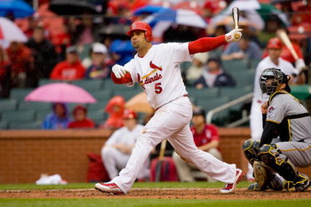 ST. LOUIS - APRIL 9:  Albert Pujols #5 of the St. Louis Cardinals follows through on his swing during the MLB game against the Pittsburgh Pirates on April 9, 2009 at Busch Stadium in St. Louis, Missouri.  The Cardinals defeated the Pirates 2-1.  (Photo by