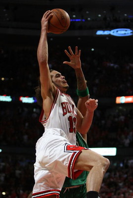 CHICAGO - APRIL 30: Joakim Noah #13 of the Chicago Bulls goes up for a shot against the Boston Celtics in Game Six of the Eastern Conference Quarterfinals during the 2009 NBA Playoffs at the United Center on April 30, 2009 in Chicago, Illinois. The Bulls