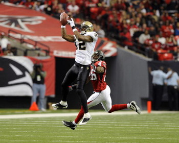 ATLANTA - NOVEMBER 9: Wide receiver Marques Colston #12 of the New Orleans Saints grabs a midfield pass against the Atlanta Falcons at the Georgia Dome on November 9, 2008 in Atlanta, Georgia.  (Photo by Al Messerschmidt/Getty Images)