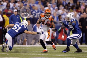 INDIANAPOLIS - DECEMBER 07:  T.J. Houshmanzadeh #84 of the Cincinnati Bengals runs for yards after the catch against Jordan Senn #51 and Raheem Brock #79 of the Indianapolis Colts at Lucas Oil Stadium on December 7, 2008 in Indianapolis, Indiana.  (Photo