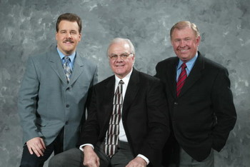 PHILADELPHIA - MARCH 2:  (L-R) Philadelphia Flyers TV broadcasters Jim Jackson, Gary Dornhoefer and Steve Coates pose for a photo before the game against the New York Rangers at the Wachovia Center on March 2, 2006 in Philadelphia, Pennsylvania. The Range