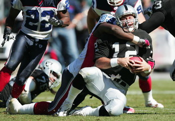 OAKLAND, CA - SEPTEMBER 19:  Rich Gannon #12 of the Oakland Raiders is sacked by Pat Williams #93 of the Buffalo Bills at Network Associates Coliseum on September 19, 2004 in Oakland, California. (Photo by Jed Jacobsohn/Getty Images)
