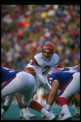 26 Nov 1989: Quarterback Boomer Esiason of the Cincinnati Bengals (center) stands behind center during a game against the Buffalo Bills at Rich Stadium in Orchard Park, New York. The Bills won the game, 24-7.