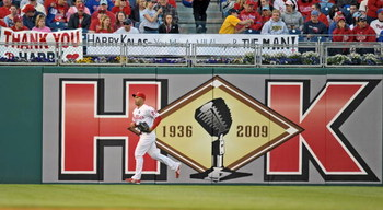 PHILADELPHIA - APRIL 17: Raul Ibanez #29 of the Philadelphia Phillies runs past a sign dedicated to recently departed Philadelphia Phillies announcer Harry Kalas during the game against the San Diego Padres on April 17, 2009 at Citizens Bank Park in Phila