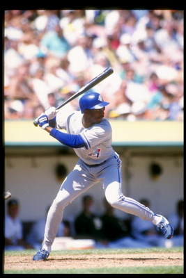 Sep 1993:  Devon White of the Toronto Blue Jays swings at the ball during a game against the Oakland Athletics at the Oakland Coliseum in Oakland, Califoria. Mandatory Credit: Otto Greule  /Allsport