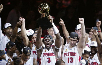 AUBURN HILLS, MI - JUNE 15:  Ben Wallace #3 (C) of the Detroit Pistons holds up the Larry O'Brien NBA Championship trophy as he celebrates with teammatesafter defeating the Los Angeles Lakers 100-87 in game five of the 2004 NBA Finals on June 15, 2004 at
