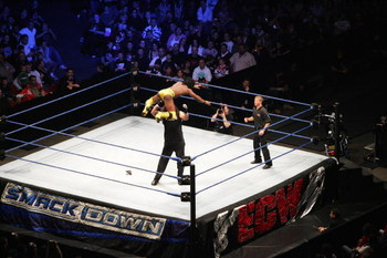 SYDNEY, AUSTRALIA - JUNE 15:  Kofi Kingston leaps from the turnbuckle against Chuck Palumbo during WWE Smackdown at Acer Arena on June 15, 2008 in Sydney, Australia.  (Photo by Gaye Gerard/Getty Images)
