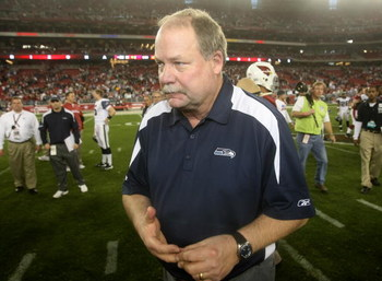 GLENDALE, AZ - DECEMBER 28:  Head coach Mike Holmgren of the Seattle Seahawks walks off the field after the game with the Arizona Cardinals on December 28, 2008 at University of Phoenix Stadium in Glendale, Arizona.  The Cardinals won 34-21.  (Photo by St