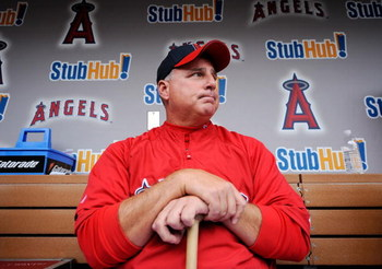 ANAHEIM, CA - APRIL 10:  Mike Scioscia #14 manager of the Los Angeles Angels reflects on pitcher Nick Adenhart's death as he answers questions in the dugout at Angel Stadium April 10, 2009 in Anaheim, California. Adenhart and two others were killed in car