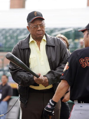 SCOTTSDALE, AZ - MARCH 1:  Hall of Famer Willie Mays gives actor Rob Schnieder batting instuctions during San Francisco Giants Spring Training on March 1, 2006 in Scottsdale, Arizona.  (Photo by Tom Hauck/Getty Images)