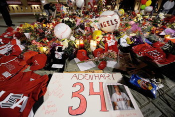 ANAHEIM, CA - APRIL 10:  Fans gather around a makeshift memorial to Los Angeles Angels pitcher Nick Adenhart outside Angel Stadium, after the game against the Boston Red Sox on April 10, 2009 in Anaheim, California. Adenhart and two others were killed in