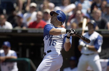 KANSAS CITY, MO - JUNE 24:  Outfielder Carlos Beltran #15 of the Kansas City Royals swings at a Detroit Tigers pitch during the game at Kauffman Stadium on June 24, 2004 in Kansas City, Missouri. The Tigers won 12-3. (Photo by Dave Kaup/Getty Images)