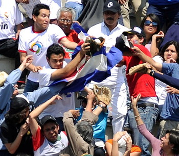 MEXICO CITY - MARCH 08:  Fans fight for the home run ball hit by Frederich Cepeda # 24 of Cuba during the game against South Africa at the 2009 World Baseball Classic Pool B match on March 8, 2009 at the Estadio Foro Sol in Mexico City, Mexico.  Cuba won,