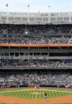 NEW YORK - APRIL 17:  A view of Yankee Stadium from center field during the New York Yankees game against the Cleveland Indians on April 17, 2009 in the Bronx borough of New York City. Many of the high priced seats behind home plate remained empty during