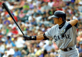 8 Apr 2001:  Seattle Mariners #51 Ichiro Suzuki sticks his bat out before taking a pitch against the Texas Rangers at the Ballpark in Arlington, Texas.  DIGITAL IMAGE Mandatory Credit: Ronald Martinez/ALLSPORT