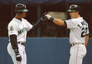 8 Oct 1995: SEATTLE CENTER FIELDER KEN GRIFFEY JR. CELEBRATES WITH TEAMMATE TINO MARTINEZ, AFTER GREFFEY HIT A SOLO HOMERUN IN THE 8TH INNING, MAKING THE SCORE 3-4 DURING THE MARINERS GAME VERSUS THE NEW YORK YANKEES IN GAME FIVE OF THE AMERICAN LEAGUE PL