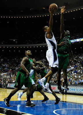 ORLANDO, FL - MARCH 25:  Rashard Lewis #9 of the Orlando Magic attempts a shot over Kendrick Perkins #43 of the Boston Celtics on March 25, 2009 at Amway Arena in Orlando, Florida.  NOTE TO USER: User expressly acknowledges and agrees that, by downloading