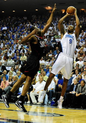 ORLANDO, FL - APRIL 28:  Rashard Lewis #9 of the Orlando Magic shoots over Willie Green #33 of the Philadelphia 76ers in Game Five of the Eastern Conference Quarterfinals during the 2009 NBA Playoffs at Amway Arena on April 28, 2009 in Orlando, Florida. N